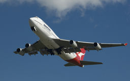 Qantas Boeing 747. A Qantas Boeing 747 in flight, set against azure blue sky Stock Photography