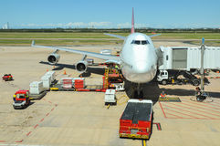 Qantas Boeing 747-400 is being loaded Royalty Free Stock Image