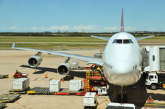 Qantas Boeing 747-400 is being loaded Stock Photos
