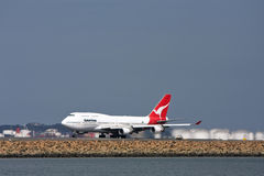 Qantas Boeing 747 airliner  on the runway Stock Photo