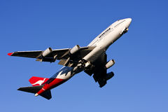 Qantas Boeing 747 airliner taking off. Qantas airlines Boeing 747 jet airliner taking off from Sydney Airport Royalty Free Stock Photography