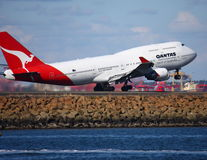 Qantas Boeing 747 jet taking off. From Sydney, Australia Royalty Free Stock Image
