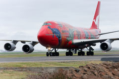Qantas Boeing 747 jet taxis on the runway. Qantas Boeing 747 with aboriginal art design, on the runway in Sydney, Australia Royalty Free Stock Image