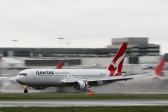 Qantas Boeing 767 with background motion blur. Stock Photos