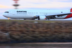 Qantas Boeing 767 in motion. With blurred background Royalty Free Stock Photography