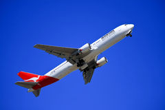 Qantas Boeing 767 taking off. Qantas Boeing 767 climbing after takeoff Royalty Free Stock Photos