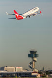 Qantas Boeing 737-800 aircraft taking off from Sydney Airport. Sydney, Australia - May 5, 2014: Qantas Boeing 737-800 aircraft taking off from Sydney Airport Stock Photography