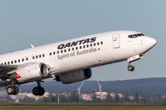 Qantas Boeing 737-800 aircraft taking off from Sydney Airport. Royalty Free Stock Photo
