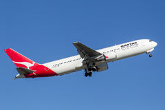 Qantas Boeing 767 airliner taking off from Sydney Airport. Stock Photo