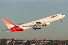 Qantas Boeing 767 airliner taking off from Sydney Airport. Royalty Free Stock Photography