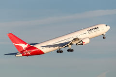 Qantas Boeing 767 airliner taking off from Sydney Airport. Sydney, Australia - May 5, 2014: Qantas Boeing 767 airliner taking off from Sydney Airport Stock Photo