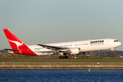 Qantas Boeing 767 airliner taking off from Sydney Airport. Royalty Free Stock Photos