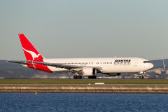 Qantas Boeing 767 airliner taking off from Sydney Airport. Royalty Free Stock Photo