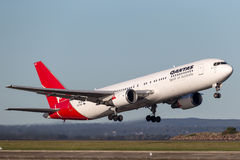 Qantas Boeing 767 airliner taking off from Sydney Airport. Stock Images