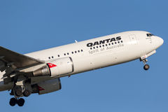 Qantas Boeing 767 airliner taking off from Sydney Airport. Stock Photos