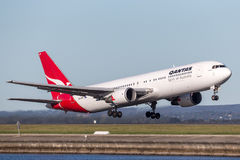 Qantas Boeing 767 airliner taking off from Sydney Airport. Royalty Free Stock Images