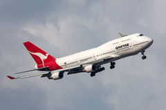 Qantas Boeing 747-438/ER VH-OEH turning to land at Melbourne International Airport. Stock Photo