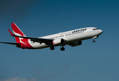 Qantas Boeing 737-838 in flight Royalty Free Stock Images