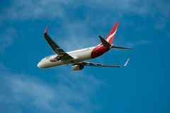 Qantas Boeing 737-800 in flight Royalty Free Stock Images