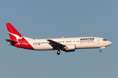 Qantas Boeing 737-476 VH-TJJ on approach to land at Melbourne International Airport. Melbourne, Australia - September 25, 2011: Qantas Boeing 737-476 VH-TJJ on Royalty Free Stock Photography