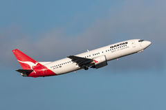 Qantas Boeing 737-476 VH-TJK departing Melbourne International Airport. Melbourne, Australia - September 24, 2011: Qantas Boeing 737-476 VH-TJK departing Royalty Free Stock Photo