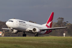 Qantas Boeing 737-476 VH-TJU departing Melbourne International Airport. Melbourne, Australia - November 10, 2011: Qantas Boeing 737-476 VH-TJU departing Stock Photo