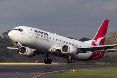 Qantas Boeing 737-476 VH-TJU departing Melbourne International Airport. Melbourne, Australia - November 10, 2011: Qantas Boeing 737-476 VH-TJU departing Royalty Free Stock Photo