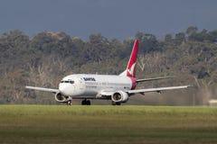 Qantas Boeing 737-476 VH-TJU on the runway at Melbourne International Airport. Melbourne, Australia - November 10, 2011: Qantas Boeing 737-476 VH-TJU on the Royalty Free Stock Photo