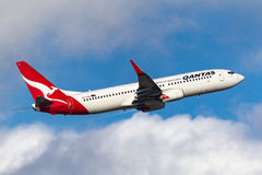 Qantas Boeing 737-838 VH-VXA departing Melbourne International Airport. Royalty Free Stock Photos