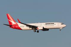 Qantas Boeing 737-838 VH-VXG on approach to land at Melbourne International Airport. Melbourne, Australia - September 25, 2011: Qantas Boeing 737-838 VH-VXG on Stock Photography