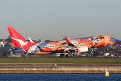 Qantas Boeing 737-800 `Yananyi Dreaming` with its distinctive aboriginal artwork. Sydney, Australia - May 5, 2014: Qantas Boeing 737-800 `Yananyi Dreaming` with Royalty Free Stock Photo