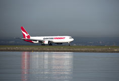 QANTAS Freighter lands at Kingston_Smith airport, Sydney Royalty Free Stock Image