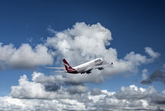QANTAS jet and white clouds Royalty Free Stock Images