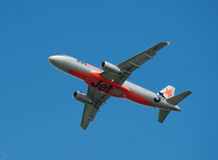 Qantas/JetStar Boeing 737-800 in flight Stock Photography