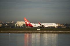 QANTAS passenger jet departs Kingston_Smith airport, Sydney Royalty Free Stock Photos
