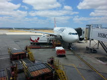 Qantas passenger plane being loaded on the tarmac Perth Western Australia Royalty Free Stock Photos