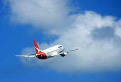 Qantas reaching for the sky. Qantas 767 Jet flying away Stock Image