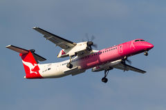 QantasLink de Havilland Canada DHC-8-402Q Dash 8 Q400 VH-QOH aircraft wearing a pink colour in support of breast cancer charitie Stock Photos