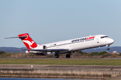 QantasLink Qantas Boeing 717 regional jet airliner taking off from Sydney Airport. Stock Image