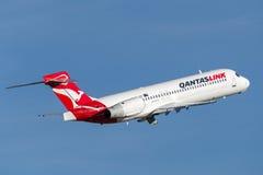 QantasLink Qantas Boeing 717 regional jet airliner taking off from Sydney Airport. Sydney, Australia - May 5, 2014: QantasLink Qantas Boeing 717 regional jet Royalty Free Stock Photo