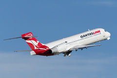 QantasLink Qantas Boeing 717 regional jet airliner taking off from Sydney Airport. Stock Photo