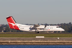 QantasLink Qantas deHavilland DHC-8 Dash 8 twin engined regional airliner aircraft departing Sydney Airport. Stock Photography