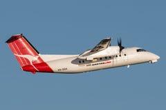 QantasLink Qantas deHavilland DHC-8 Dash 8 twin engined regional airliner aircraft departing Sydney Airport. Royalty Free Stock Photo