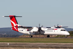 QantasLink Qantas deHavilland DHC-8 Dash 8 twin engined regional airliner aircraft at Sydney Airport. Royalty Free Stock Image