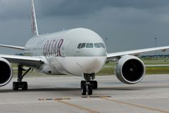 Qatar airlines. Qatar passenger jet arriving at docking port Stock Photo