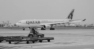 Qatar airplane on the runway at Tan Son Nhat Airport Stock Image