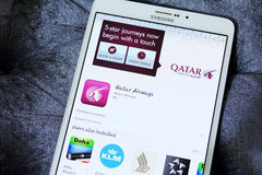 Qatar airways app. Downloading qatar airways application from google play store on samsung tab s2 stock photo