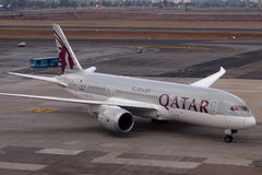 Qatar Airways. Based in Doha and serving 125 international destinations, Qatar Airways is the state-owned flag carrier of Qatar royalty free stock images