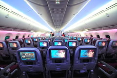 Qatar Airways' Boeing 787-8 Dreamliner economy class cabin at Singapore Airshow Stock Photo