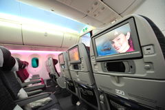 Qatar Airways' Boeing 787-8 Dreamliner economy class inflight entertainment system (IFE) at Singapore Airshow Royalty Free Stock Images